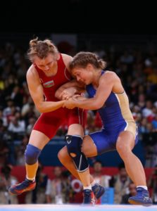 LONDON, ENGLAND - AUGUST 09: Yuliya Ratkevich of Azerbaijan (red) and Valeriia Zholobova of Russia compete in the Women's Freestyle 55 kg Wrestling on Day 13 of the London 2012 Olympic Games at ExCeL on August 9, 2012 in London, England. (Photo by Quinn Rooney/Getty Images)