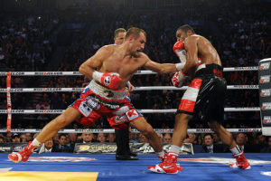 MONTREAL, QC - MARCH 14: Sergey Kovalev (left) land a body punch on Jean Pascal during their unified light heavyweight championship bout at the Bell Centre on March 14, 2015 in Montreal, Quebec, Canada. (Photo by Richard Wolowicz/Getty Images)